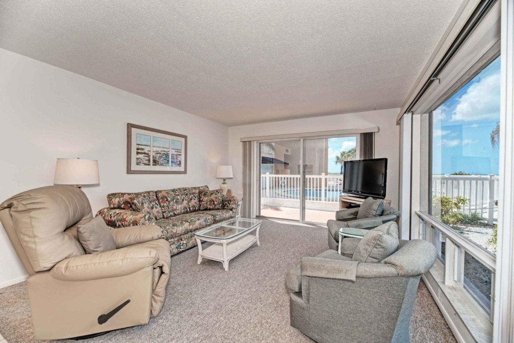 Lighting Lamp furniture including comfort couch  Cofee Table  Chair Television inside the laminate flooring Condominium