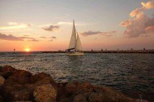 Sailing Boat in the sea during sunset having cloud in the sky
