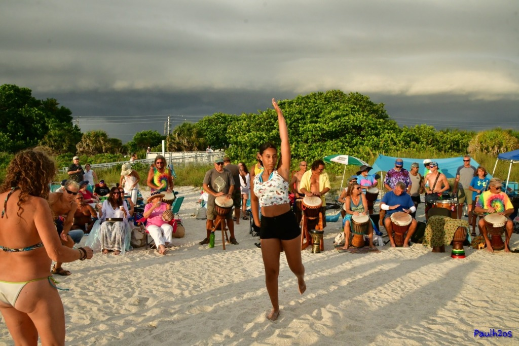 A girl is dancing on beach